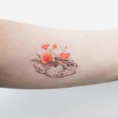 Bunny tattoo by Sol Tattoo #SolTattoo #bunnytattoo #watercolor #painterly #illustrative #linework #fineline #realistic #bunny #rabbit #flowers #poppies #nature #animal