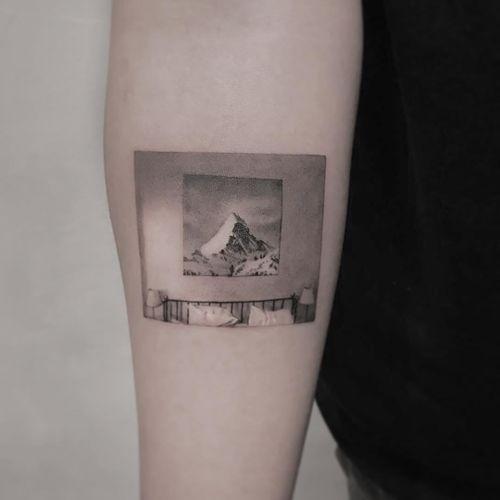 Bedroom scene tattoo by Cold Gray #ColdGray #blackandgrey #realism #realistic #hyperrealism #room #bedroom #mountain #lamps #bed #sleep #stilllife #photo #sky