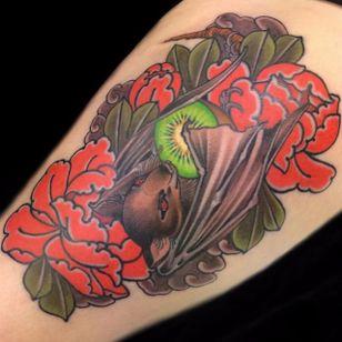 Fruit bat snacking on a kiwi. Tattoo by En Tattooer. #neojapanese #neotraditional #kiwi #fruit #bat #fruitbat #EnTattooer