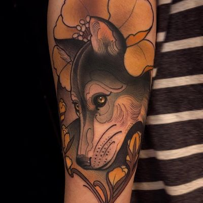 Lovely little wolf tattoo by Chris Green #ChrisGreen #color #neotraditional #wolf #dog #coyote #animal #wildlife #flowers #magnolia #leaves #nature #tattoooftheday