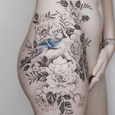 Hip piece by Tritoan Ly #TritoanLy #flower #bird #blackandgrey #realism #tattoooftheday