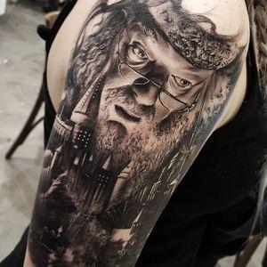 Black and grey Hogwarts (with Dumbledore) tattoo by Chris Mata'afa. #ChrisMataafa #blackandgrey #dumbledore #wizard #portrait #HarryPotter #hogwarts #castle #popculture #film