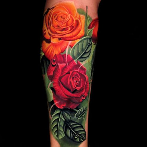 Realistic rose tattoo by Jose Guevara Morales #JoseGuevaraMorales #besttattoos #color #realism #realistic #hyperrealism #rose #flowers #leaves #nature #dewdrops #rosebud #tattoooftheday
