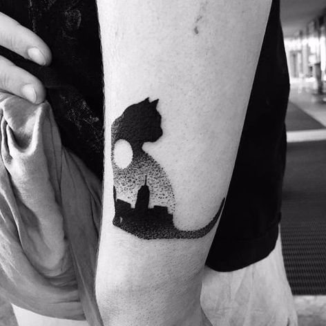 The skyline of a city underneath a full moon inside this cat silhouette by Sebastiano Perezzetta (IG—sebastiano_perazzetta). #cat #city #landscapes #moon #SebastianoPerezzetta #silhouette
