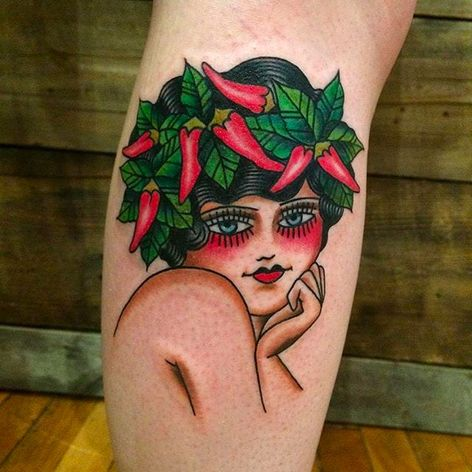 A girl with chili peppers on her head. Tattoo by Anem. #Anem #traditionaltattoo #girl #girltattoo #chilipepper #traditional #traditionalgirl