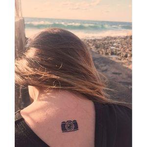 Nicole Noa's photography tattoo. #photography #camera #photo #photographer #contemporaryart