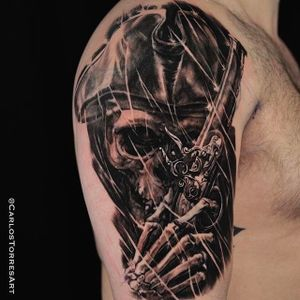 Incredible detail work on this skull tattoo with a pistol done by Carlos Torres. #carlostorres #blackandgrey #skull