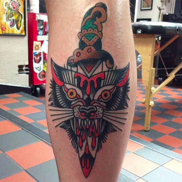 Wolf head and dagger by Bailey Tattooer. #BaileyTattooer #SacredElectric #traditionaltattoo #bizzare #wolf #dagger