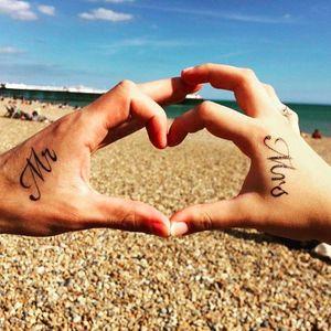 Mr. and Mrs. Couple tattoos via #janisch_ on Instagram #coupletattoo #coupletattoos #matchingtattoos #romantic #tattooedcouple #lovetattoos #mrandmrs #calligraphy