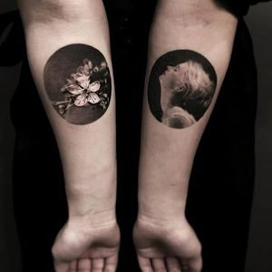 Who ever said bangers have to be simple? Lovely pair of matching small tattoos by Jeong Hwi Jeon. #blackandgrey #cherryblossom #JeongHwiJeon #portraiture #realism