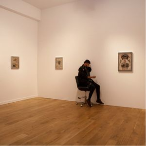 Scott Campbell tattoos through a hole at event in London #wholeglorylondon #art #tattooing #mysterytattoo