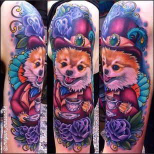 Megan Massacre puts her own mad twist on this pomeranian tattoo. #dog #pomeranian #MeganMassacre #dapper #flower #neotraditional