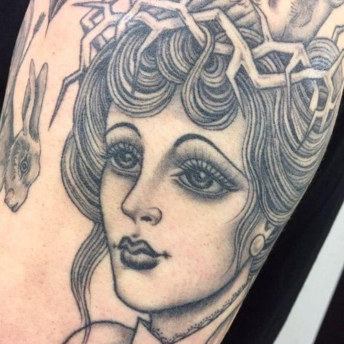 Lady head tattoo by Sarah Schor #SarahSchor #ladyheadtattoo #blackandgrey #oldschool #traditional #crownofthorns #lady #portrait #eyes #pearls #hair #thorns #crown #rabbit #tattoooftheday