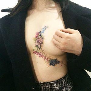 Floral underboob/sternum tattoo by Doy. #doy #tattooistdoy #southkorea #southkorean #underboob #sternum