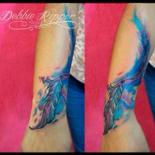 Blue and purple watercolor feather tattoo by Debbie Ripper. #watercolor #DebbieRipper #feather