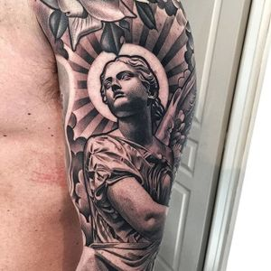 A statuesque tattoo of a female angel via Lil B (IG—lilbtattoo). #angel #blackandgrey #LilB #realism #religious #RobinHernandez