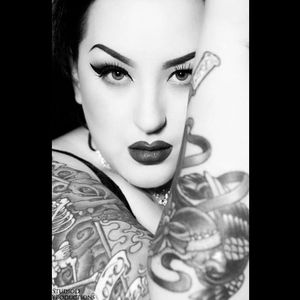 Her tattoos have a touch of the traditional style in them Photo by Studio D #KeroseneDeluxe #plusmodel #tattooedlady #model #fetish #pinup #tattoomodel #StudioD
