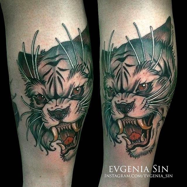 Solid and clean bobcat head tattoo by Evgenia Sin. #EvgeniaSin #neotraditional #coloredtattoo #bobcat #bobcathead