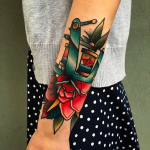 Another solid looking rose and coil machine tattoo by Chris Papadakis. #ChrisPapadakis #traditionaltattoo #rose #coil #tattoomachine