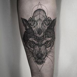 Wolf and Skull Tattoo by Thomas Bates #wolf #wolftattoo #blackwork #blackworktattoo #blackink #illustrative #illustration #blacktattoos #blackworkartist #ThomasBates