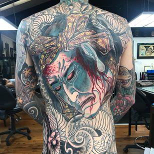 Namakubi back piece tattoo by Ryan Ussher #RyanUssher #namakubitattoo #color #Japanese #backpiece #bodysuit #severedhead #clouds #portrait #snake #samurai #blood #bloodsplatter #warrior #death #tattoooftheday