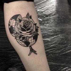 A globe opens up to reveal a rose inside, by Iain Sellar (via IG—iainsellar) #scrimshaw #blacktattoo #linework #traditional #iainsellar