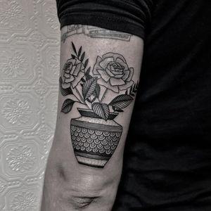 Potted rose tattoo by Justin Olivier #JustinOliver #planttattoos #blackwork #linework #dotwork #rose #rosebuds #leaves #flowers #floral #pattern #vase #ornamental #tattoooftheday