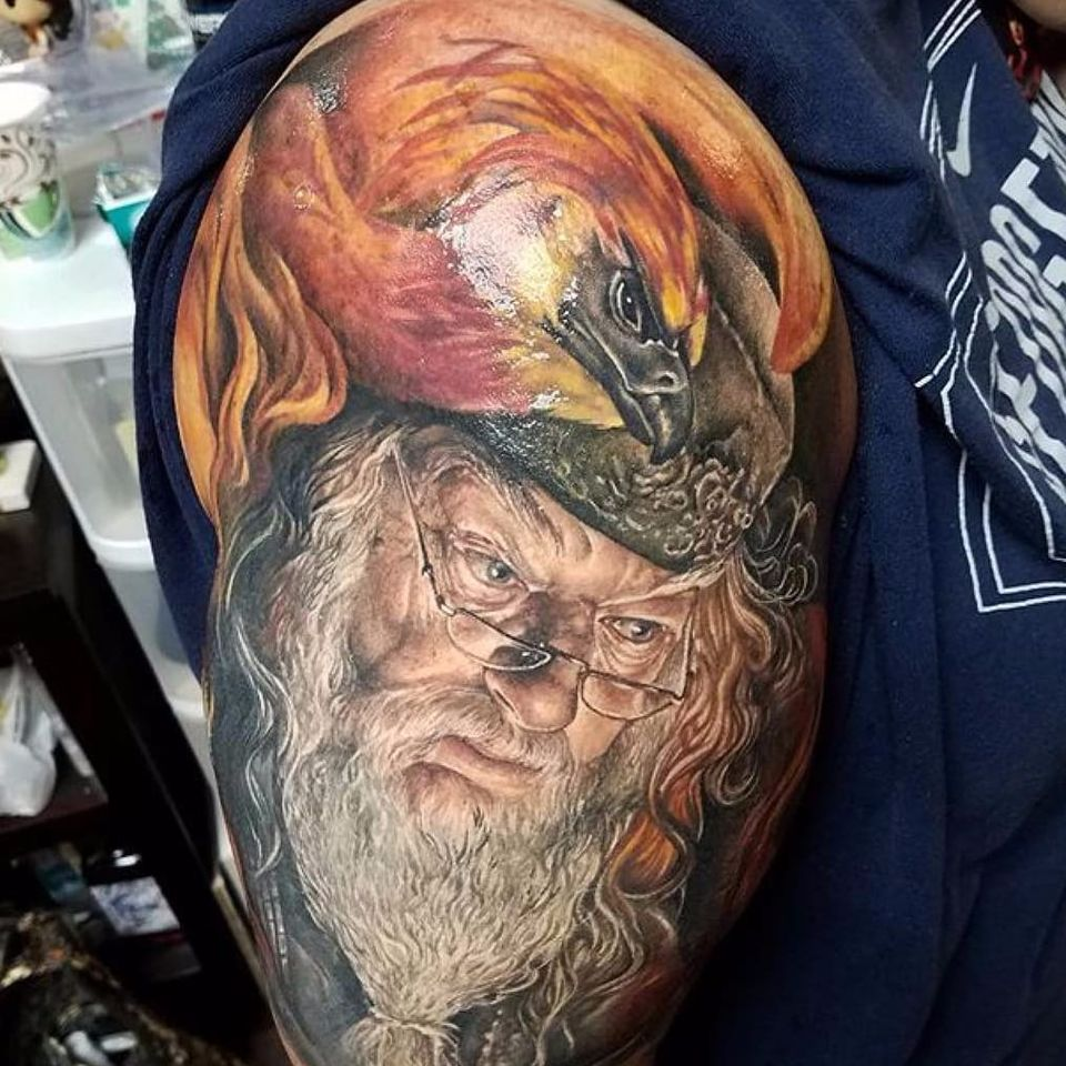 Sick #dumbledore tattoo by @sarahmillertattoo