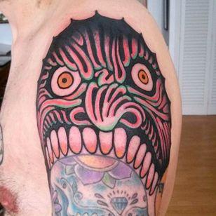 Sick shoulder face tattoo done by El Carlo. #ElCarlo #ElCarloTattoos #boldtattoos #surreal #shoulder #face