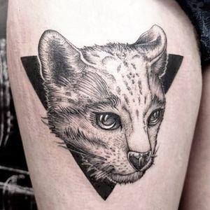 Interesting cat tattoo by Gabor Zolyomi. #GaborZolyomi #FatumTattoo #blackwork #illustrativetattoo #wildcat