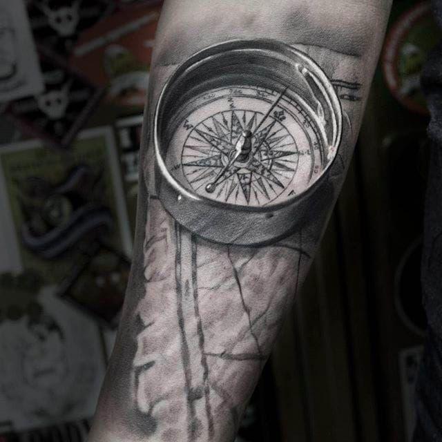 Solid looking compass tattoo done by Anastasia Forman. #AnastasiaForman #realistic #blackandgray #compass