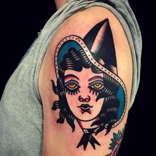 Solid and clean witch head tattoo done by Mark Cross. #MarkCross #rosetattooNYC #TraditionalTattoo #BoldTattoos #witch #girlhead