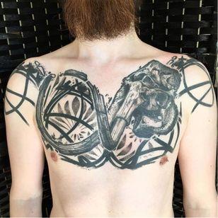 Prehistoric skull tattoo by Ergo Nomik #ErgoNomik #blackwork #skull #graphic