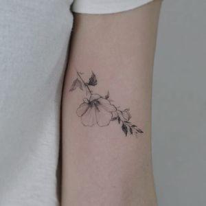 Magnolia flower tattoo by Tattooist Flower #TattooistFlower #flowertattoos #koreanartist #fineline #linework #realism #realistic #simple #minimal #small #flower #magnolia #leaves #nature #tattoooftheday