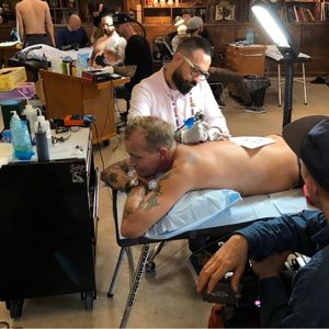 Chris Núñez tattooing a client during the show #thetattooshop #miami #wynwood #tvseries