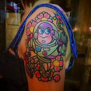 Buzz lightyear and blossoms tattoo by @pikkapimingchen #cartoon #cartoonstyle #neotraditional #bright_and_bold #toystory #buzzlightyear #disney #disneymovie #DisneyPixar #Pixar