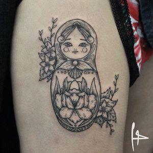 Russian doll tattoo by Harry Plane. #russiandoll #flowers #blackwork #linework #HarryPlane