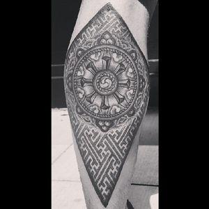 Shane Gann's Dharma Wheel tattoo. Tattooed by Michael E. Bennett. (via IG - michael.e.bennett) #ShaneGann #HailTheSun #DharmaWheel