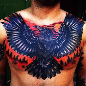A badass cover-up chest-piece of a raven in a forest at sunset by Sloo Hamilton (IG—slootattoos). #coverup #forest #JeremySlooHamilton #neotraditional #vibrant #raven