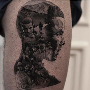 Stranger Things tattoo by Inal Bersekov #InalBersekov #tvtattoos #blackandgrey #realism #realistic #hyperrealism #abstract #cubist #portrait #netflix #tvshow #strangerthings #11 #eleven #landscape #mountains #night #tattoooftheday