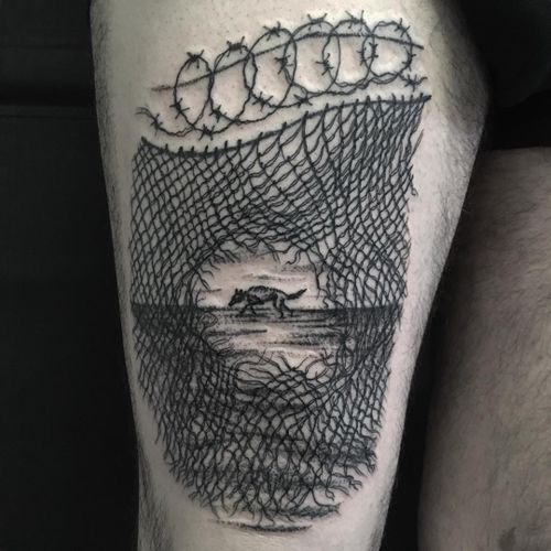 Through the fence. Tattoo by Servadio #Servadio #illustrativetattoos #illustrative #linework #fineline #dotwork #landscape #barbedwire #fence #wolf #dog #wild #animal #freedom