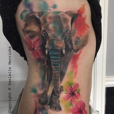 Vibrant elephant and flower watercolor tattoo by Danielle Merricks (IG—paintingisntdead). #DanielleMerricks #elephant #watercolor