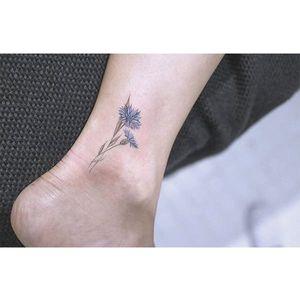 Floral tattoo by Baam. #Baam #TattooerBaam #subtle #microtattoo #southkorean #fineline #ankle #floral #flower