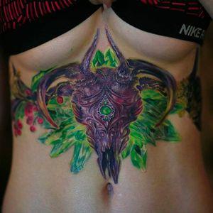 Awesome animal skull and some crystals on the sternum. Tattoo done by Nika Samarina. #nikasamarina #coloredtattoo #surrealtattoo #organic #animalskull #emerald #crystals