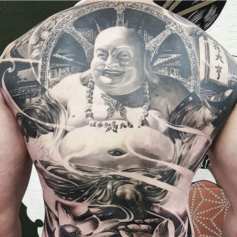 Buddha by Chris Mata'afa just chilling on this guy's back (IG—chris_showstoppr). #blackandgrey #Buddha #ChrisMataafa