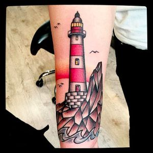 Traditional lighthouse tattoo by @Capratattoo #Capratattoo #traditional #black #red #SkullfieldTattoo #lighthouse #lighthousetattoo