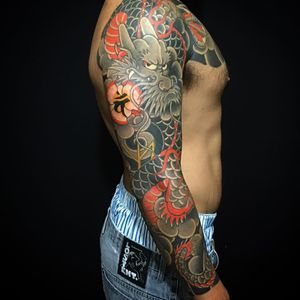 A sleeve with a dragon holding a magical orb by Caio Pineiro (IG—caiopineiro). #CaioPineiro #dragon #Irezumi #Japanese #traditional