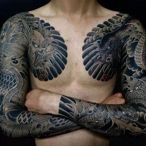 Horihide David Chu (IG—horihide_david) matching Irezumi sleeves of a dragon, koi, and two snakes. #dark #dragon #HorihideDavidChu #Irezumi #koi #sleeves #snakes #traditional