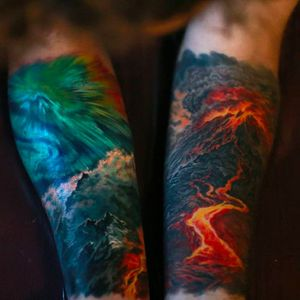 The sea and waves, volcanic scenery on the other, awesome vibrant tattoos by Nika Samarina. #nikasamarina #coloredtattoo #surrealtattoo #organic  #volcanic #sea #waves #forearm