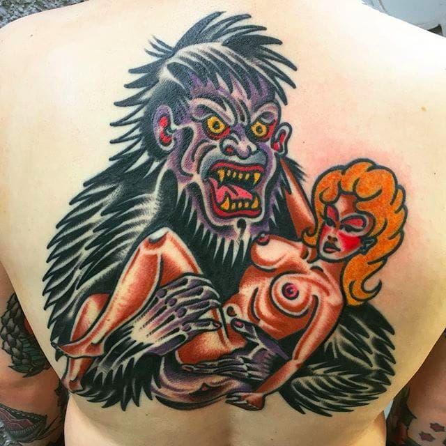 Crazy looking gorilla tattoo holding a pinup girl. Rad tattoo by Alex Wild! #AlexWild #traditionaltattoo #boldtattoos #gorilla #woman #pinup